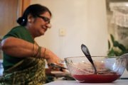 Ranu Pal picks out food for her Thanksgiving dinner Thursday evening. Pal and her husband, Dhananjay, played host to a Thanksgiving dinner at their home, complete with American favorites such as turkey and mashed potatoes and traditional Indian foods.