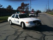 Police vehicles block off a portion of Lakeview Road while officers investigate reports of a suspicious package.