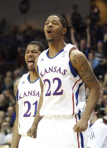 Kansas forwards Markieff Morris (21) and Marcus Morris (22) react to a dunk by teammate Elijah Johnson during the second half against Ohio, Friday, Nov. 26, 2010 at the Orleans Arena.