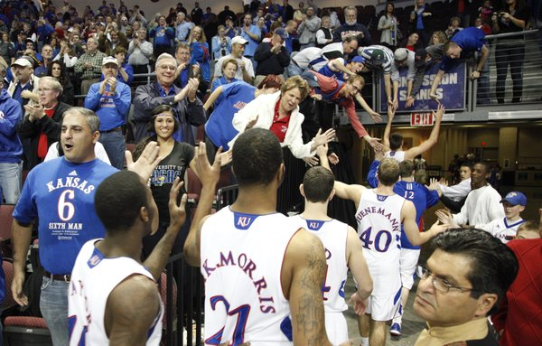 Kansas fans slap hands with the Jayhawks as they leave the floor following their 98-41 win over Ohio, Friday, Nov. 26, 2010 at the Orleans Arena.