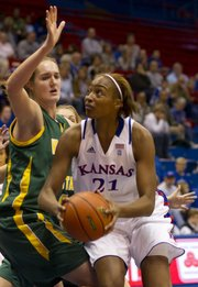 With the ball in the low post, Kansas University forward Carolyn Davis (21) prepares to put up a shot over North Dakota State University center Janae Burich during their game Friday night in Allen Fieldhouse. The Jayhawks defeated the Bison 61-53.
