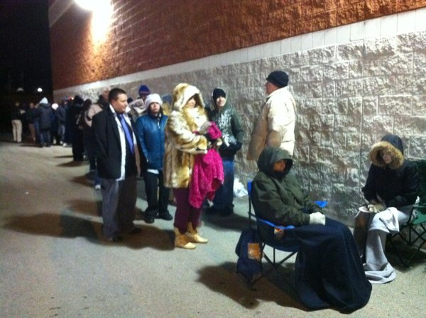 Anxious shoppers wait outside Best Buy in Lawrence hoping to score some deals early on Black Friday.