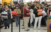 Shoppers wait for open registers after making purchases at Kohl's Department Store, on Black Friday, Nov. 26, 2010. After the midnight opening of Old Navy, Koh'ls and JC Penney's had 3 a.m. openings for their day-after-Thanksgiving sales.