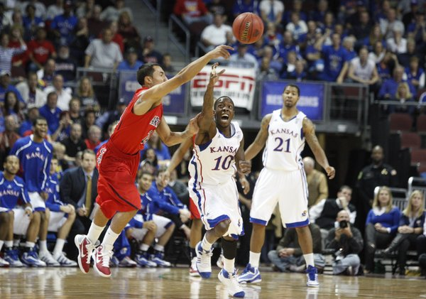 Kansas guard Tyshawn Taylor knocks the ball loose from Arizona forward Brendon Lavender during the first half of the Las Vegas Invitational, Saturday, Nov. 27, 2010 at the Orleans Arena.