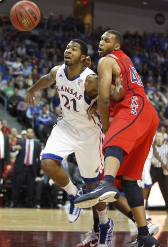 Kansas forward Markieff Morris wrestles for a loose ball with Arizona forward Jamelle Horne during the first half of the Las Vegas Invitational, Saturday, Nov. 27, 2010 at the Orleans Arena.