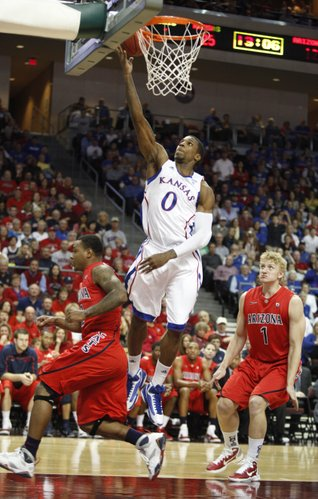 Kansas forward Thomas Robinson elevates for a bucket between  Arizona defenders Lamont Jones, left, and Kyryl Natyazhko during the first half of the Las Vegas Invitational, Saturday, Nov. 27, 2010 at the Orleans Arena.