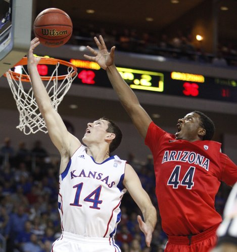 Kansas guard Tyrel Reed elevates for a bucket past Arizona forward Solomon Hill during the first half of the Las Vegas Invitational, Saturday, Nov. 27, 2010 at the Orleans Arena.