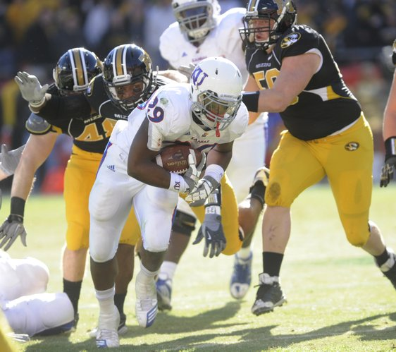 KU's James Sims (29) tries working his way through Missouri defenders. Kansas and Missouri met at Arrowhead Stadium Saturday for the 119th game in the rivalry series.