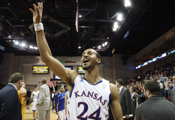 Kansas guard Travis Releford waves to the crowd following the Jayhawks' 87-79 win over Arizona, Saturday, Nov. 27, at the Orleans Arena.