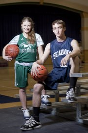 Seabury Academy senior 	basketball players Angela Thomas, left, and Reed Grabill are hoping to lead their teams to success this season.