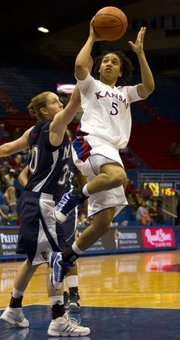 Kansas guard Keena Mays (5) hangs in the air as she puts up a shot past Maine guard Amber Smith during their game Wednesday night at Allen Fieldhouse.