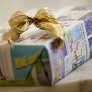 Consider wrapping gifts with recycled or reusable items, like the newspaper's comic section, old maps or a child's artwork