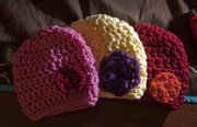 Some of the hats for infants Katheryn Claypool makes. Her crocheted items will be one of the many artist will have for sale at the Holiday Extravaganza at the Douglas County Fairgrounds, Building 21.