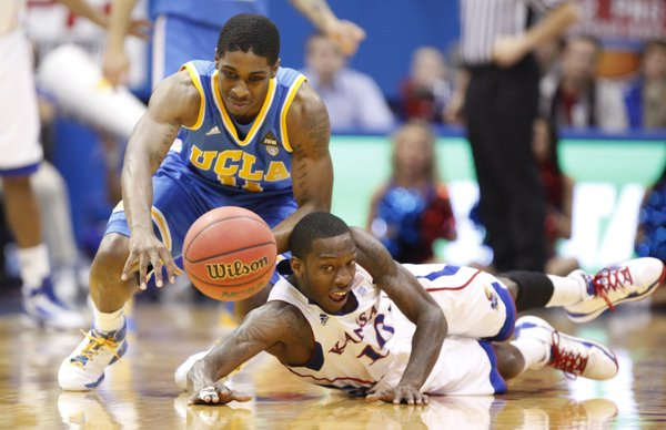 Kansas guard Tyshawn Taylor knocks the ball loose from UCLA guard Lazeric Jones during the first half, Thursday, Dec. 2, 2010 at Allen Fieldhouse.