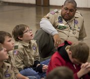 Schuyler Bailey, right, has received the prestigious Silver Beaver Award from the Heart of America Council for his more than 15 years of volunteer service to Boy Scout Troop 59, chartered to Lawrence First Presbyterian Church. During a recent scout meeting, Bailey listens while, from left, Steele Jacobs, George Woolverton and Matthew Solcher talk about an upcoming campout.