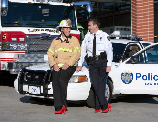 Mark Bradford, left, Douglas County Fire and Medical chief, and Tarik Khatib, Lawrence police chief, are featured in the 2011 Red Shoe calendar. They are pictured in front of fire station No. 5 on Stewart Avenue.