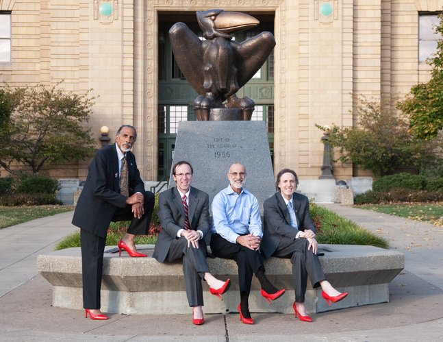 From left, Shade Little, husband of Kansas University Chancellor Bernadette Gray-Little; Danny Anderson, dean of the School of Liberal Arts and Sciences at KU; John Nalbandian, professor of public administration at KU; and Rick Ginsberg, dean of the school of education, are pictured in front Strong Hall. The photo is featured in the 2011 Red Shoe calendar that raises money for The Willow Domestic Violence Center.