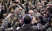 President Barack Obama greets members of the military Friday at a rally during an unannounced visit at Bagram Air Field in Afghanistan.