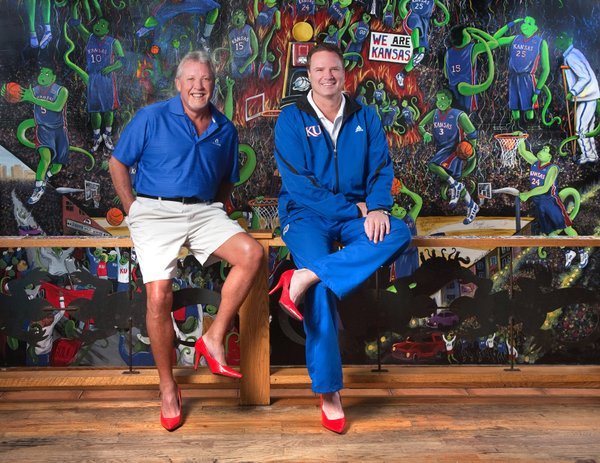 Dan Chandler, owner of The Salty Iguana, and Coach Bill Self are featured in the 2011 Red Shoe calendar. It raises awareness about domestic violence and money for The Willow Domestic Violence Center in Lawrence.