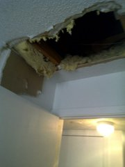 A hole gapes in the ceiling of an apartment in the 1100 block of Louisiana Street. Five people were arrested early Saturday morning for burglaries in the area.