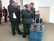 "Debaters gather between rounds of the Lawrence High School Debate Tournament. Check out the evidence-filled luggage — with all that weight, the folks at Southwest Airlines would be regretting their ""Bags Fly Free"" campaign. The tournament ran Friday and Saturday at Lawrence High, 1901 La."
