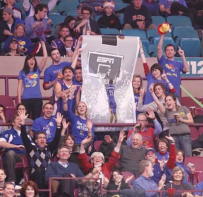 A handful of creative Kansas fans display a reminder of Mario Chalmers' game-tying shot in the 2008 National Championship game, during the first half against Memphis Tuesday, Dec. 7, 2010 at Madison Square Garden in New York City.