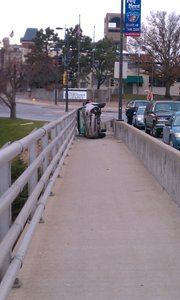 Traffic backs up on the Kansas River Bridge after a car flipped on its side at Sixth and Massachusetts streets on Thursday, Dec. 9, 2010.