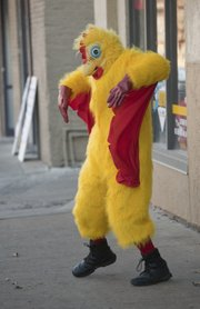 Zachary Cote, works an active shift as a dancing chicken while advertising downtown for Oh Boy! Chicken at 125 W. 10th St.