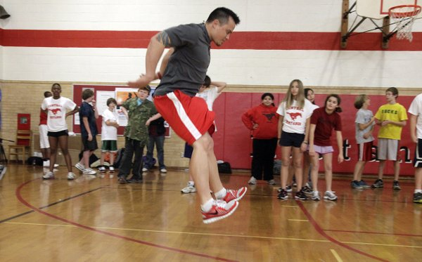 Chad Richards, owner of Next Level Sports Performance, demonstrates an exercise during the Smart Strength after-school program at Central Junior High School. The program is offered to junior high school student on Wednesdays and Fridays.