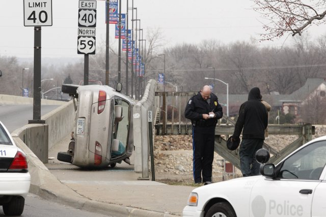A car ended up on its side and on the sidewalk on the Kansas River Bridge near Sixth and Massachusetts streets. No injuries were reported.