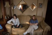 Amanda Randel, 16, and her mother, Regina, sit in the living room of their Lawrence home. Amanda is on track to completing high school via a virtual school after leaving her Baldwin City school over bullying.