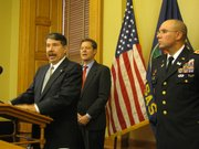 "Retired U.S. Marine Lt. Col. Ernest ""Ernie"" Garcia, Gov.-elect Sam Brownback's nominee to be superintendent of the Kansas Highway Patrol, speaks Friday during a news conference. Brownback also nominated Col. Lee Tafanelli as Kansas adjutant general."