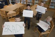 Four students at Langston Hughes School share the same, currently popular first name. Gathered in the school's library Thursday from left are Bradyn Kern, kindergarten, Braiden Bangalan, second-grade, Brayden Ballew, first grade, and Braedyn Clover, kindergarten.