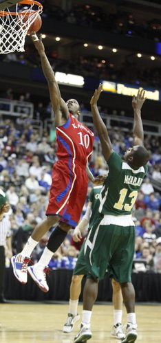 Kansas guard Tyshawn Taylor gets a bucket past Colorado State forward Andre McFarland during the first half, Saturday, Dec. 11, 2010 at the Sprint Center in Kansas City.
