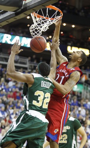 Kansas forward Markieff Morris delivers a put-back dunk over Colorado State forward Andy Ogide during the first half, Saturday, Dec. 11, 2010 at the Sprint Center in Kansas City.