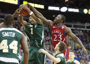 Kansas forward Mario Little goes after a rebound with Colorado State forward Travis Franklin during the first half, Saturday, Dec. 11, 2010 at the Sprint Center in Kansas City.