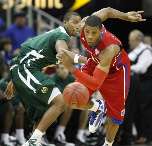 Kansas forward Thomas Robinson dribbles behind his back as he comes away with a steal from Colorado State forward Travis Franklin during the second half, Saturday, Dec. 11, 2010 at the Sprint Center in Kansas City.