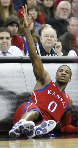 Kansas forward Thomas Robinson salutes his teammates while waiting to check in after a Jayhawk bucket against Colorado State during the second half, Saturday, Dec. 11, 2010 at the Sprint Center in Kansas City.