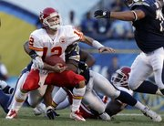 Kansas City quarterback Brodie Croyle (12) gets sacked by San Diego linebacker Stephen Cooper during the second half. The Chiefs were blanked, 31-0, Sunday in San Diego.