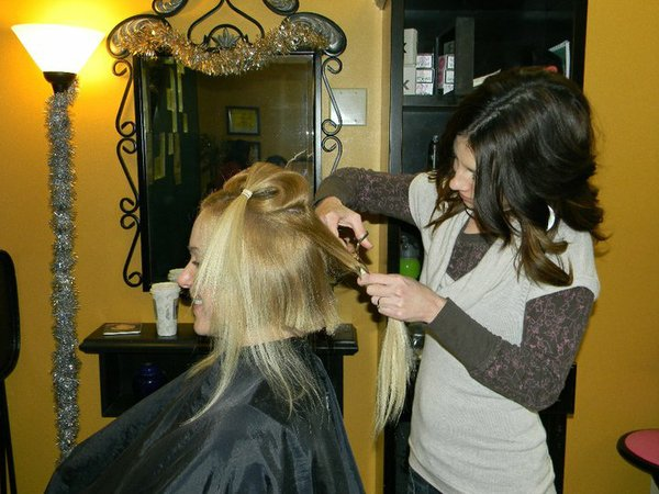 Debbie Daneke, of Static Hair Salon, cuts Karin's hair.
