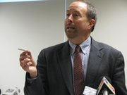 Kansas State Health Officer Dr. Jason Eberhart-Phillips on Dec. 13, 2010, holds a cigarette during a news conference on a new government report that shows the immediate health risks linked to smoking. He said everytime a Kansan lights up they should ask him or herself if this is the cigarette that will give them a deadly disease.