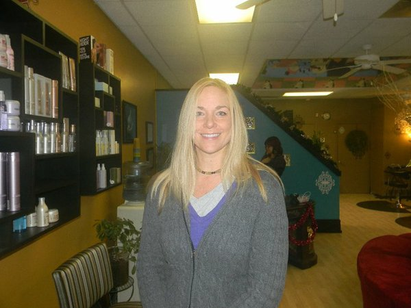 Karin Feltman is pictured Saturday, Dec. 11, 2010, before a hair cut. She donated her hair for wig for her older sister.