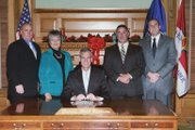 From left, Eudora City Councilmembers Tim Reazin and Ruth Hughs, Governor Mark Parkinson, Eudora Mayor Scott Hopson, and Eudora City Administrator John Harrenstein are pictured after the governor signed the proclamation making Eudora a 2nd Class city.