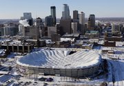 The collapsed roof of the Metrodome is shown in this aerial view in Minneapolis on Sunday. The inflatable roof of the Metrodome collapsed after a snowstorm that dumped 17 inches on Minneapolis.