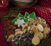Included in the holiday cookie recipes we received are, clockwise from the top: Mom's Soft Sugar Cookies, White Chocolate, Cranberry and Macadamia Nut Cookies, Swiss Sandwich Cookies, Chocolate Crinkles, False Strudel and Gingersnap Gems.