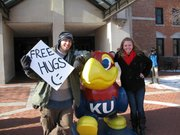 """Um, why don&squot;t you stay over there,"" Haley Harrington, a KU sophomore, seems to be saying to the Free Hugs guy spotted on campus Tuesday."