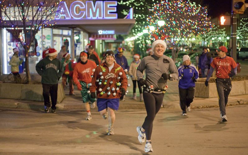 Red Dog Days participants run along Massachusetts Street during the annual Jingle Bell Jog, Thursday, Dec. 16, 2010. Dressed in their best holiday gear, the group made a quick pass through downtown, collected some money for charity and then gathered for food and drinks.