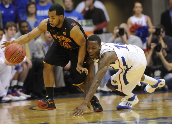 USC's Donte Smith steals from Tyshawn Taylor in the second half Saturday, Dec. 18, 2010 at Allen Fieldhouse.