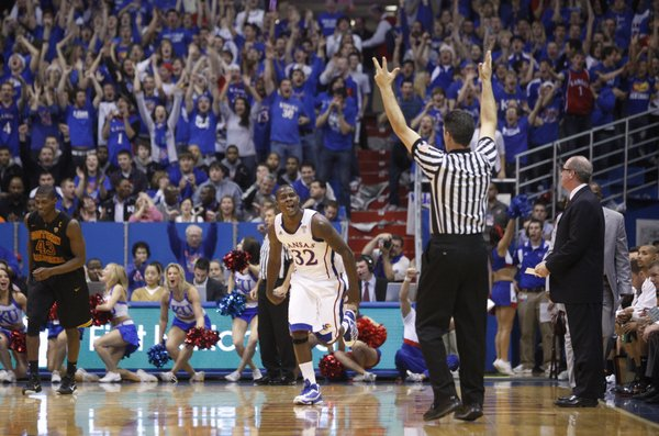 Kansas guard Josh Selby licks his chops after hitting a second three-pointer against USC during the first half, Saturday, Dec. 18, 2010 at Allen Fieldhouse.