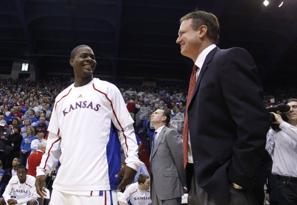 Kansas guard Josh Selby jokes with head coach Bill Self before tipoff against USC, Saturday, Dec. 18, 2010 at Allen Fieldhouse.